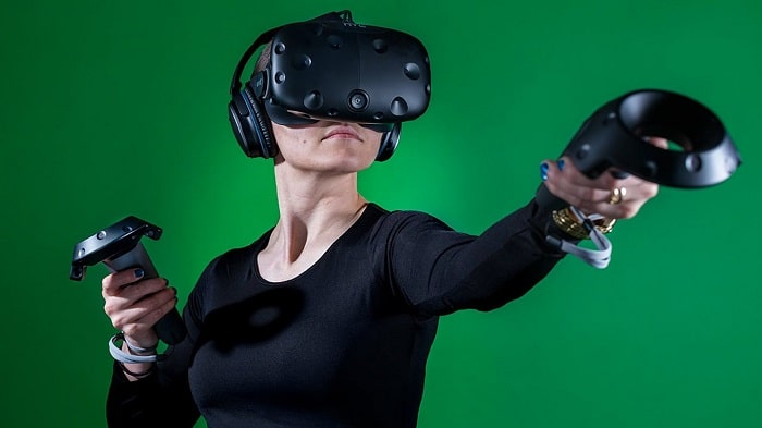Gamer woman with VR headset and controllers