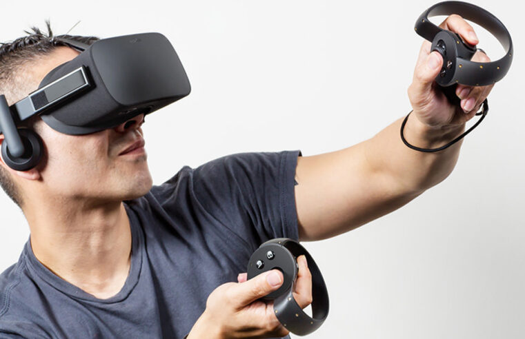 guy wearing grey shirt and VR headset for VR gaming