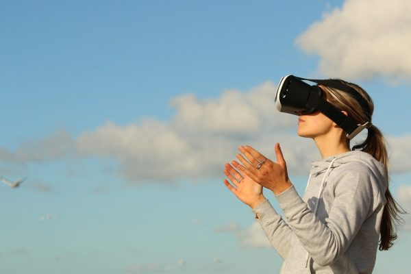 woman using dream vision vr outdoor