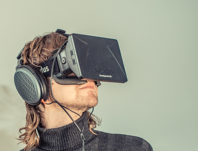 man watching videos using oculus