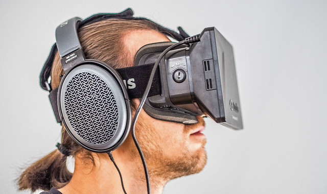 man wearing Oculus and headphone