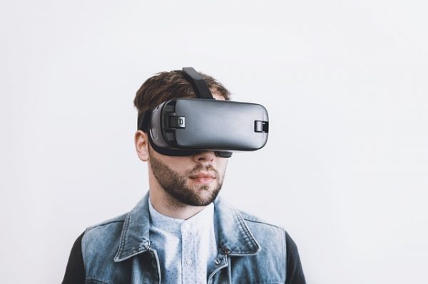 man wearing VR with white background