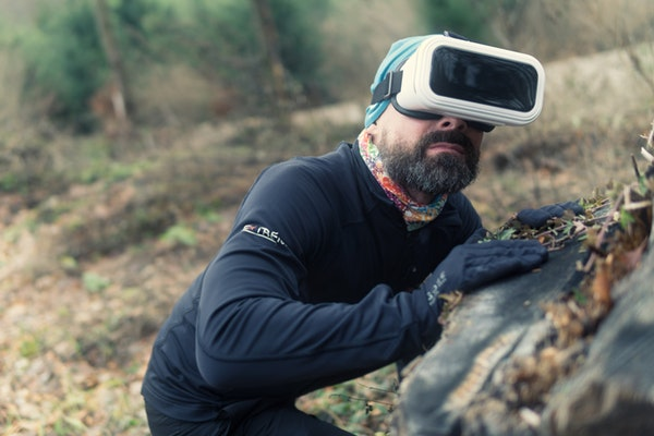 virtual reality used by guy in the forest